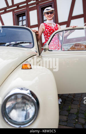 Elisabeth Weule from Stuttgart, Germany, is presenting her Volkswagen Beetle, Type 1, at classic car exhibition - Stock Photo