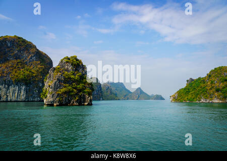 Halong bay dramatic landscape with karst islands. Ha Long Bay is UNESCO World Heritage Site and popular tourist - Stock Photo