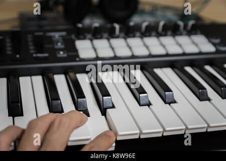 MIDI keyboard synthesizer piano keys closeup for electronic music production / recording - Stock Photo
