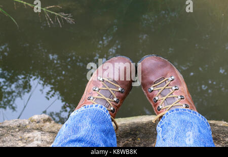 Toes Touching in Hiking Boots - Stock Photo