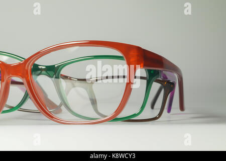 Rimmed eyeglasses closeup on a white background abstract view - Stock Photo