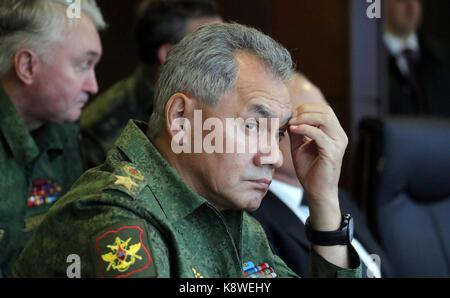 Russian Defence Minister Sergei Shoigu watches military exercise during Zapad West 2017 at the Luzhsky Range training - Stock Photo