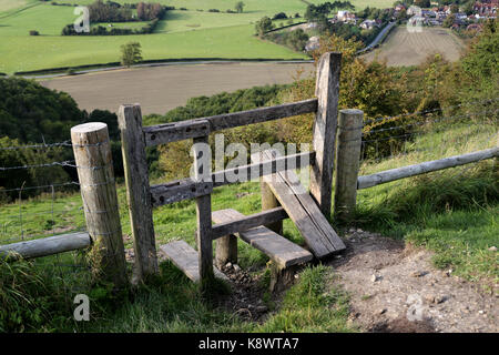 A stile at Devil's Dyke on the south Downs, over looking the village of Poynings, West Sussex United Kingdom - Stock Photo