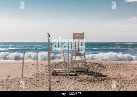empty life guard stand on an east hampton beach in eastern long island, ny - Stock Photo