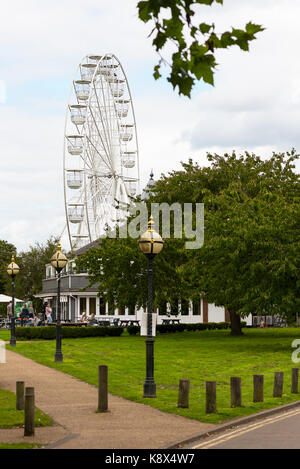 Stratford upon avon ferris wheel / observation wheel behind the river side cafe in the public parl. - Stock Photo