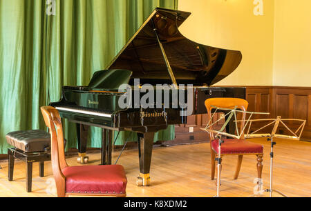 Bosendorfer grand piano, stool, and music stands for Gould Trio concert, Haddington Town Hall, East  Lothian, Scotland, - Stock Photo