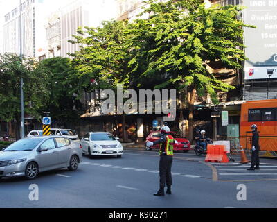 a Thai Police manage and control the traffic in the morning..  21th September, 2017. Bangkok, Thailand - Stock Photo
