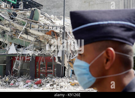 Mexico City, Mexico. 20th Sep, 2017. A man walks past a collapsed building after an earthquake in Mexico City, capital - Stock Photo