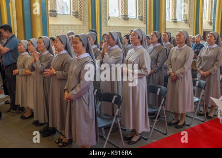 Beijing, China. 21st Sep, 2017. Chinese nuns attend a mass to celebrate the tenth anniversary of the ordination - Stock Photo
