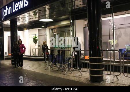 London, UK. 21st Sep, 2017. The first members of the public wait outside John Lewis, Oxford Street, London, UK, - Stock Photo