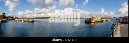 Entrance to the harbour at Padstow, a fishing village on the River Camel estuary west bank, and view of Rock, north - Stock Photo