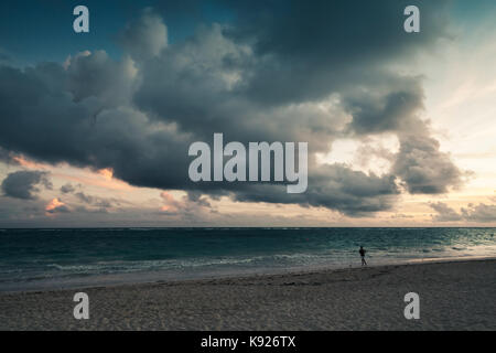Atlantic ocean coast. Landscape with dramatic stormy clouds in sunrise, Dominican republic. Punta Cana. Bavaro beach - Stock Photo