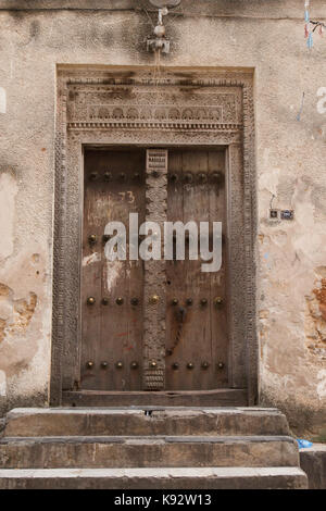 Ornate carved wooden door, Stone Town, Zanzibar, Tanzania, East Africa - Stock Photo