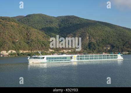 Romania, cruise boat exiting the Danube gorge - Stock Photo