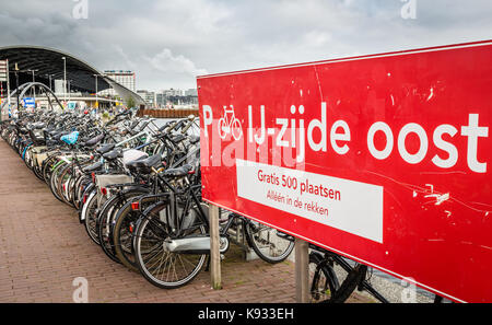 Bicycles parked in Amsterdam - Stock Photo