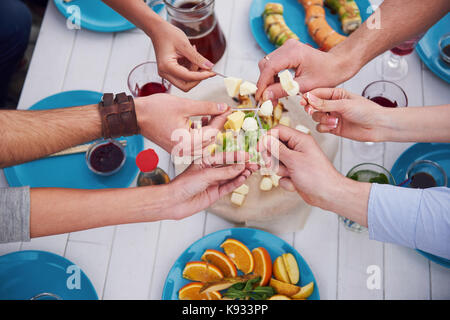 Friends birthday at a picnic - Stock Photo