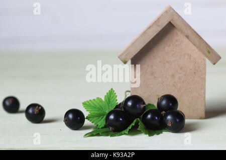 currant berry on wooden table - Stock Photo