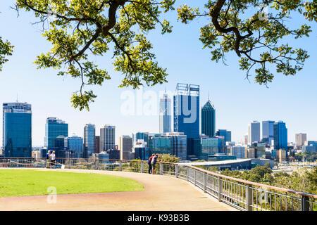 Tree framed view of the Perth city CBD from Kings Park, Western Australia, Australia - Stock Photo