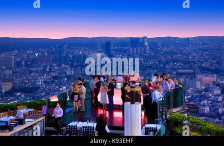 View over  'Sirocco Sky Bar' and Bangkok skyline - Stock Photo