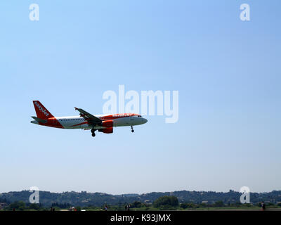 Easyjet airlines Airbus A320-214, flight number G-EZTK landing off at Ioannis Kaposistrias airport Corfu, Greece - Stock Photo