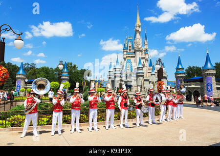 Musical band playing to the public outside the fairytale castle in Magic Kingdom, Orlando, Florida, USA - Stock Photo