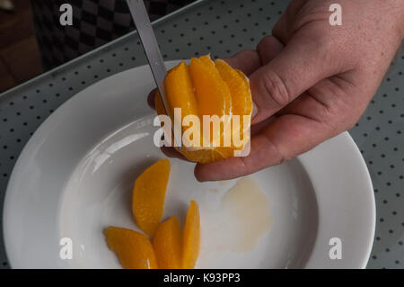 filetting oranges, Restaurant Allegria, Chef Alexander Tschebull, Hamburg, Germany - Stock Photo