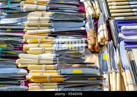 Antique silver cutlery on display at Old Spitalfields Market in London - Stock Photo