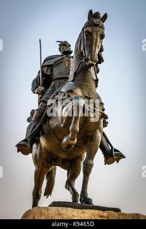 Low angle view of statue of Gjergj Kastrioti, known as Skanderberg on horseback on the main square in Tirana, Albania. - Stock Photo