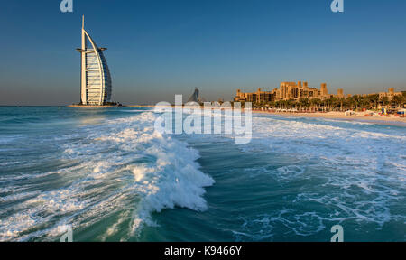 Cityscape of Dubai, United Arab Emirates, with the Burj Al Arab skyscraper on the coastline of the Persian Gulf - Stock Photo