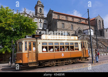 Porto city tour traditional tram and São Francisco church Porto Portugal - Stock Photo