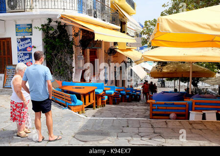 Skiathos, Greece, Septpember 09, 2017. Mother and son holidaymakers looking down to the Old Port through the Rock'n'roll - Stock Photo