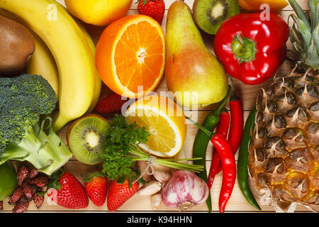 Vitamin C in fruits and vegetables. Natural products rich in vitamin C as oranges, lemons, dried fruits rose, red - Stock Photo