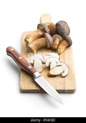Sliced boletus mushrooms on cutting board and knife. Tasty food mushrooms. - Stock Photo