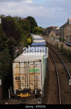 Elevated view of freight train passing Carnoustie Angus Scotland  September 2017 - Stock Photo