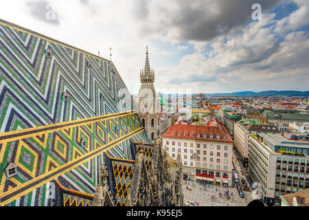 VIENNA, AUSTRIA - AUGUST 28:  St. Stephen's cathedral and eerial view over the cityscape of Vienna, Austria on August - Stock Photo