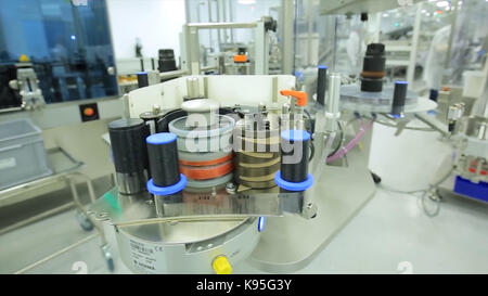 Pharmaceutics. Pharmaceutical worker operates tablet blister packaging machine. manufacture of syringes. syringe. - Stock Photo
