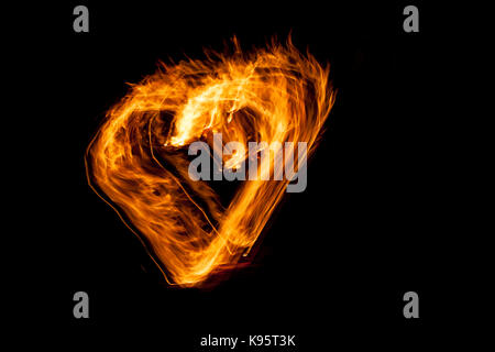 A burning heart photopainted by a camera - Stock Photo