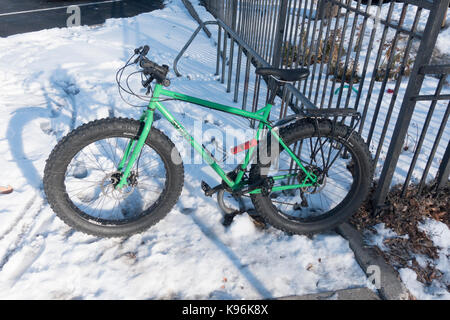 Fat tired winter bicycle parked in snow. St Paul Minnesota MN USA - Stock Photo