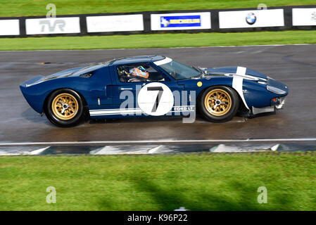 1965 Ford GT40 owned by Roald Goethe driven by Stuart Hall racing in the Whitsun Trophy at Goodwood Revival 2017. - Stock Photo