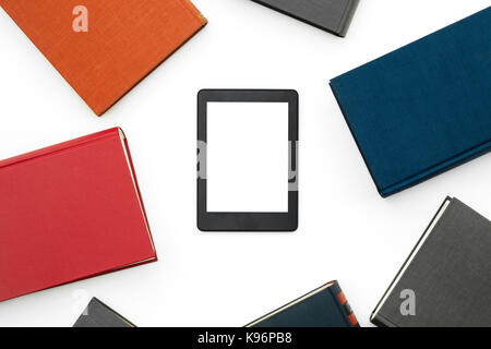 E-book device with books in white isolated background. - Stock Photo