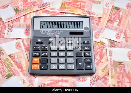 Black calculator is on the Russian banknotes five thousand rubles. Business still life - Stock Photo