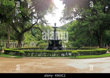 BOTANICAL GARDEN, RIO DE JANEIRO, BRAZIL - MARCH 15, 2016: Beautiful fountain surrounded by vegetation. Botanical - Stock Photo