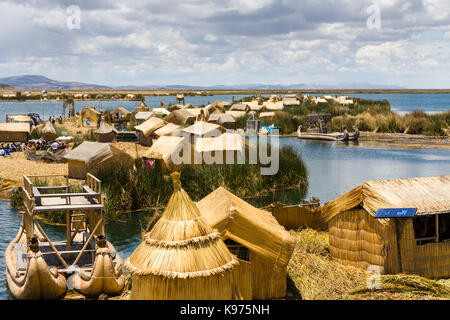 The Uros islands, reed houses and reed based islands in Lake Titikaka, Andes Highlands, Peru - Stock Photo