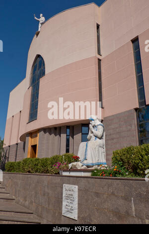 Mother Teresa statue in front St Paul's Cathedral in Tirana, Albania - Stock Photo