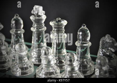 Glass Chess Pieces lined up - Stock Photo