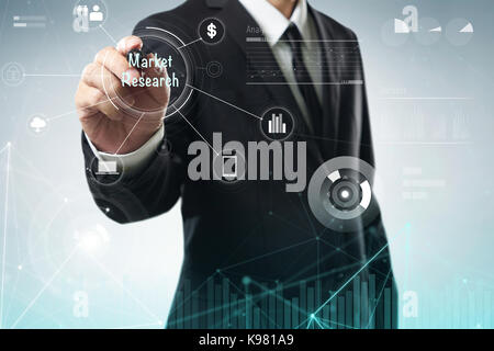Businessman draw 'Market Research' word on digital virtual screen . Hi-tech business concept . - Stock Photo