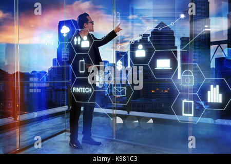 Businessman touching on digital virtual screen with fintech infographic icon . Hi-tech business concept . - Stock Photo