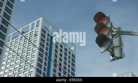 Traffic light changes from red to greent In The City. Traffic light In The City - Stock Photo
