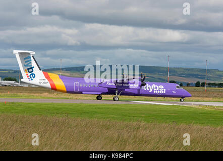 FlyBe Bombardier Dash 8 Q400 at Inverness airport ready for take off. - Stock Photo