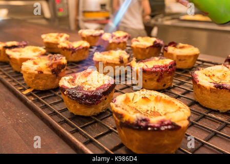 Pastries being made in a Sydney bakery early in the morning for sale that day - Stock Photo